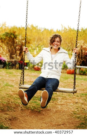 Young Woman on a Swing in the Fall