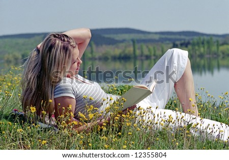 young woman on green grass