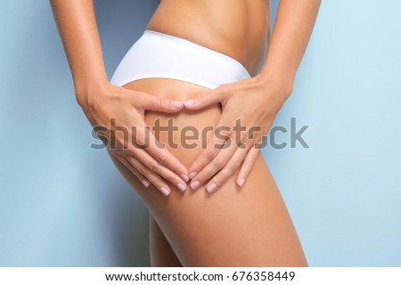 Young woman on light background. Cellulite problem concept Сток-фото ©
