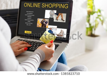 Young Woman On Sofa Shopping Online With Debit Card #1385823710