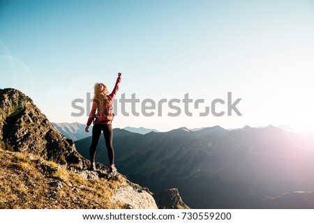 Young woman on the top in the caucasus mountains