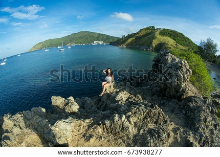 Young woman on the top of the mountain in the sea - Shutterstock ID 673938277