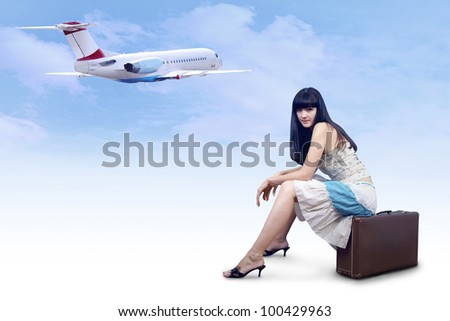 Young woman on the vintage baggage wait on the flying