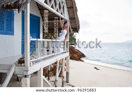 Young woman  on tropical beach house