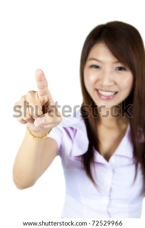 Young woman on white background is pressing on empty space