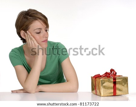 Young woman opening a gift.young woman looking a gift.
