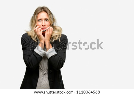 Young woman operator from call center terrified and nervous expressing anxiety and panic gesture, overwhelmed #1110064568