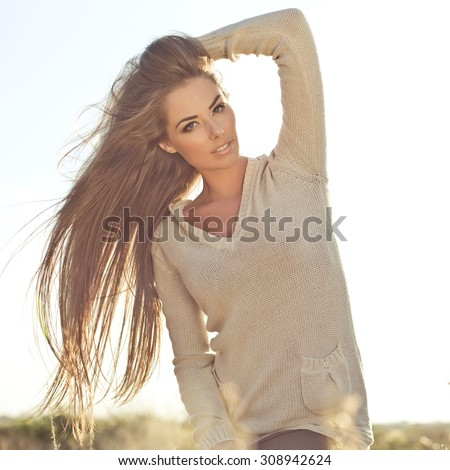 Young woman outdoor  in soft sunny daylight