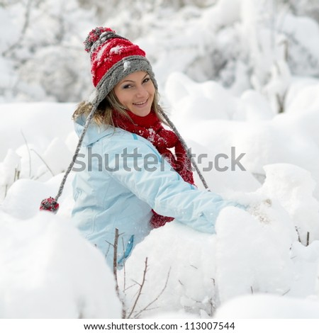 young woman outdoor in winter enjoying the snow