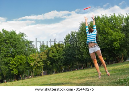 Young woman outdoor jumping