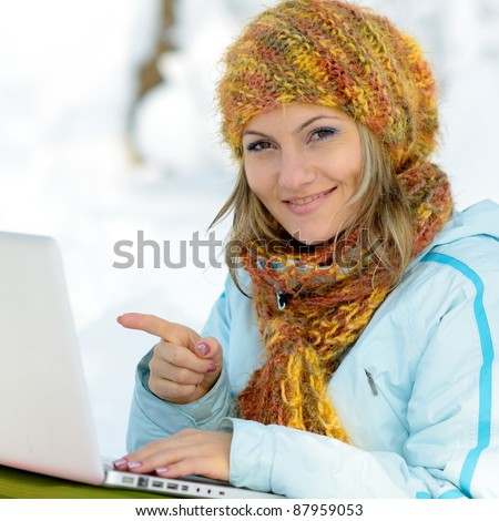 young woman outdoor using laptop
