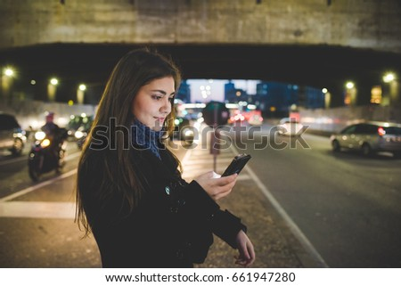 YOung woman outdoor using smart phone hand hold face illuminated by screen light - social network, communication, technology concept #661947280