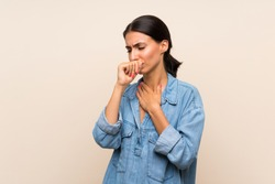 Young woman over isolated background is suffering with cough and feeling bad