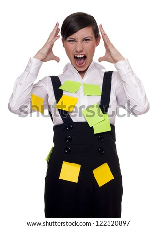 Young woman overwhelmed and stressed with too many tasks