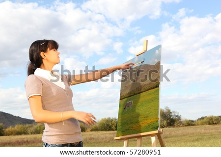 Young woman painting landscape