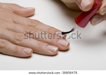 Young woman painting nails