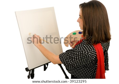 Young woman painting on a blank canvas
