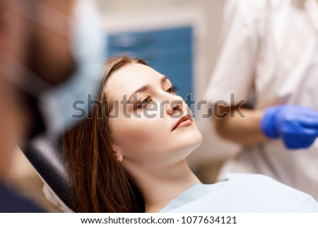 Young woman patient waiting treatment in stomatology clinic.