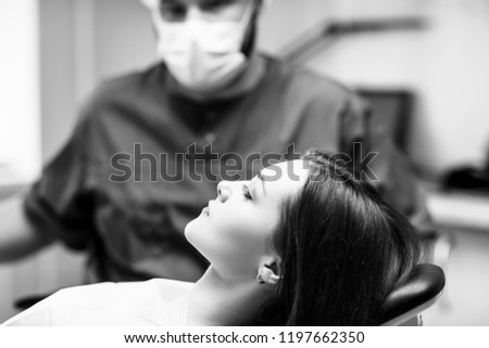 Young woman patient waiting treatment in stomatology clinic. Stomatology care concept.