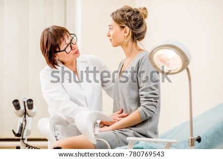 Young woman patient with a senior gynecologist during the consultation in the gynecological office