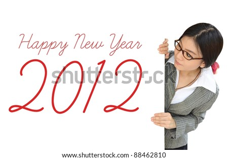 Young woman peeping over billboard with new year letter
