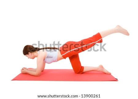Young woman performing fitness exercises on the ground