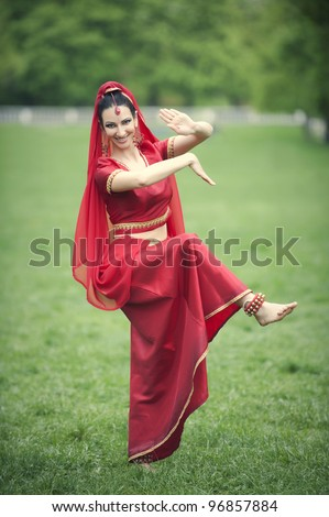 Young woman performing Indian dance
