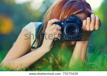 Young woman photographer portrait. Soft colors. - stock photo