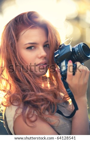 Young woman photographer. Soft colors and shallow doff.