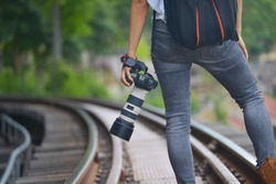 Young woman photographer Travel on public railways (Outdoor)