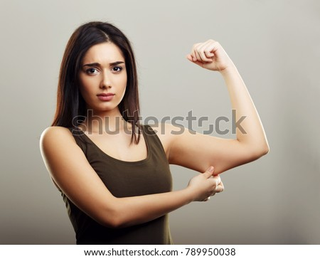 Young woman pinching arm fat flabby skin