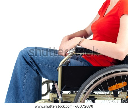 young woman pinned to wheelchair by handcuffs