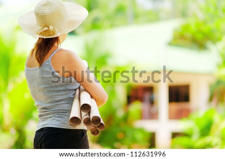 Young woman  planning  work at outdoor. - stock photo