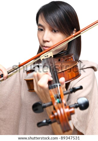 Young woman play violin - stock photo