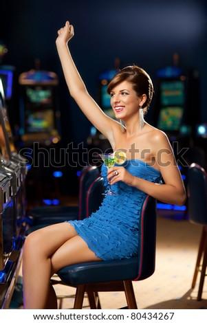 young woman playing celebrating arcade winning