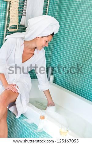Young woman playing foam bathroom bubblebath home bathrobe hygiene
