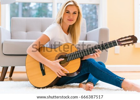 Young girl plays guitar naked you has