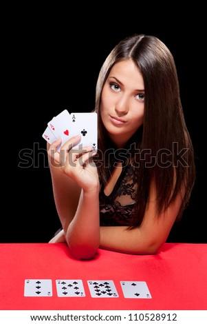 young woman playing in the gambling in casino