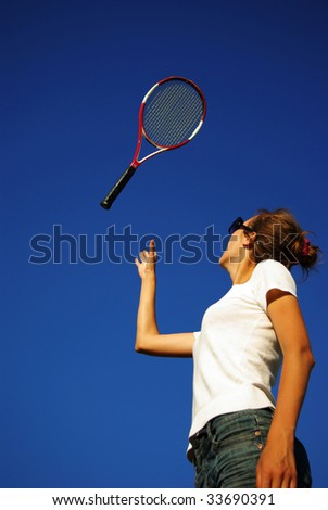 Young woman playing tennis in the sun