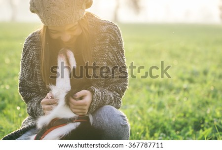 Young woman playing with her border collie dog. concept about animals and people #367787711