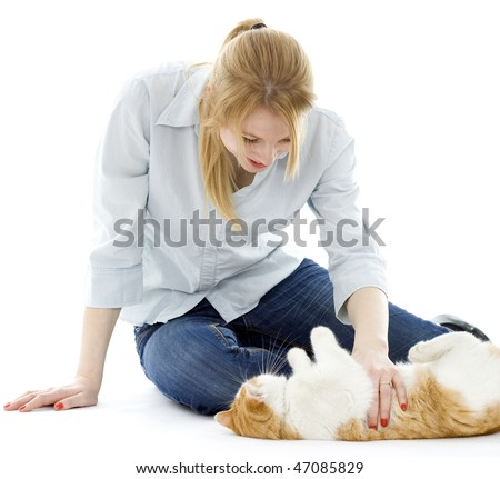 young woman playing with white ore cat