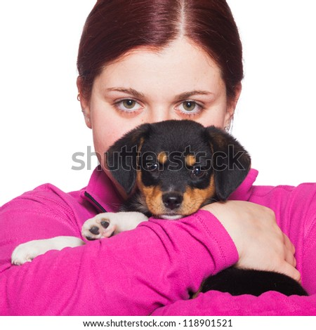 Young Woman Plyaing with Little Dog