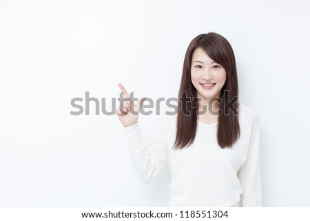 Young woman pointing copy space
