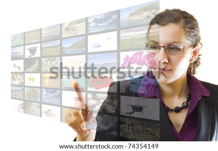 Young woman pointing multimedia screen, on white background