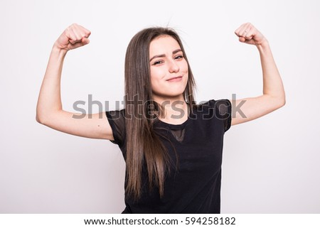 Young woman points to the strong hands on a gray