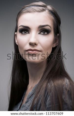Young woman portrait. Closeup beauty studio shoot.
