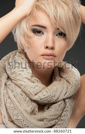 Young woman portrait. Closeup beauty studio shoot. Healthy clean skin and perfect makeup on beautiful face of white model with short blonde hair. Beautiful girl