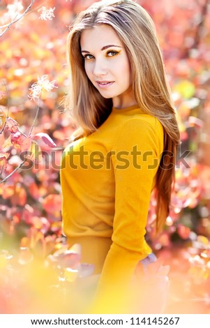 young woman portrait in autumn color