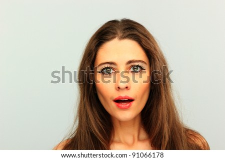 young woman portrait in studio over neutral background #91066178
