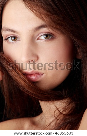Young woman portrait isolated on black background